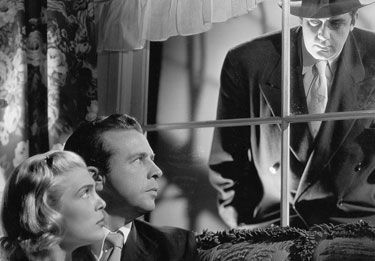Elizabeth Scott and Dick Powell in THE PITFALL