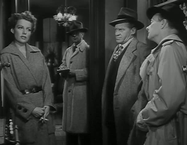 Ann Sheridan (far left) sasses Robert Keith (far right) in WOMAN ON THE RUN