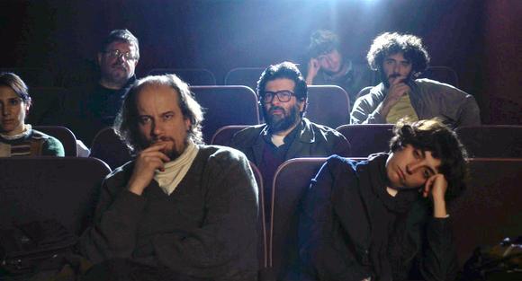 Rafael Spregelburd (center, with glasses) in THE FILM CRITIC