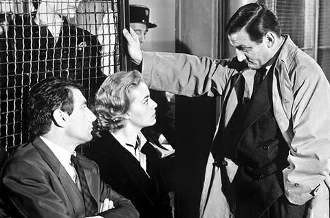Jeanne Moreau (center) and Lino Venura (right) in ELEVATOR TO THE GALLOWS
