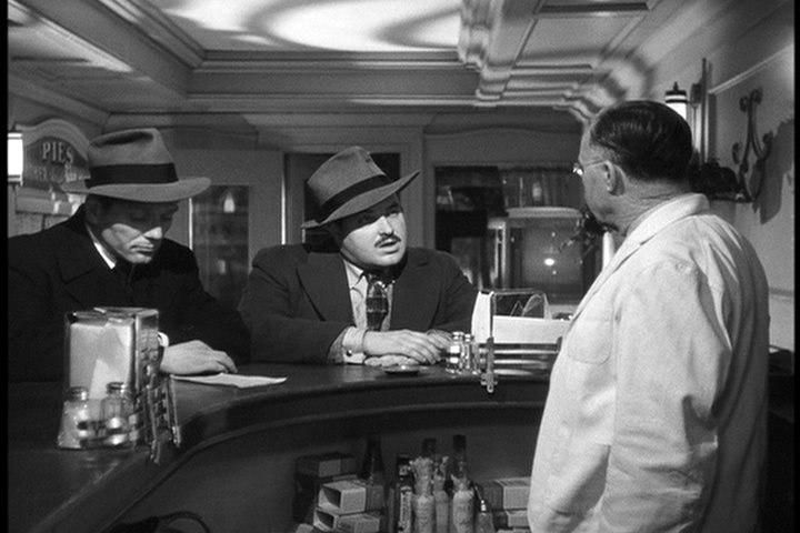 Charles McGraw (left) and Broderick Crawford (center) are the title characters in THE KILLERS