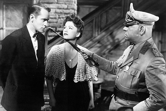 Franchot Tone, xxx and XXX in FIVE GRAVES TO CAIRO